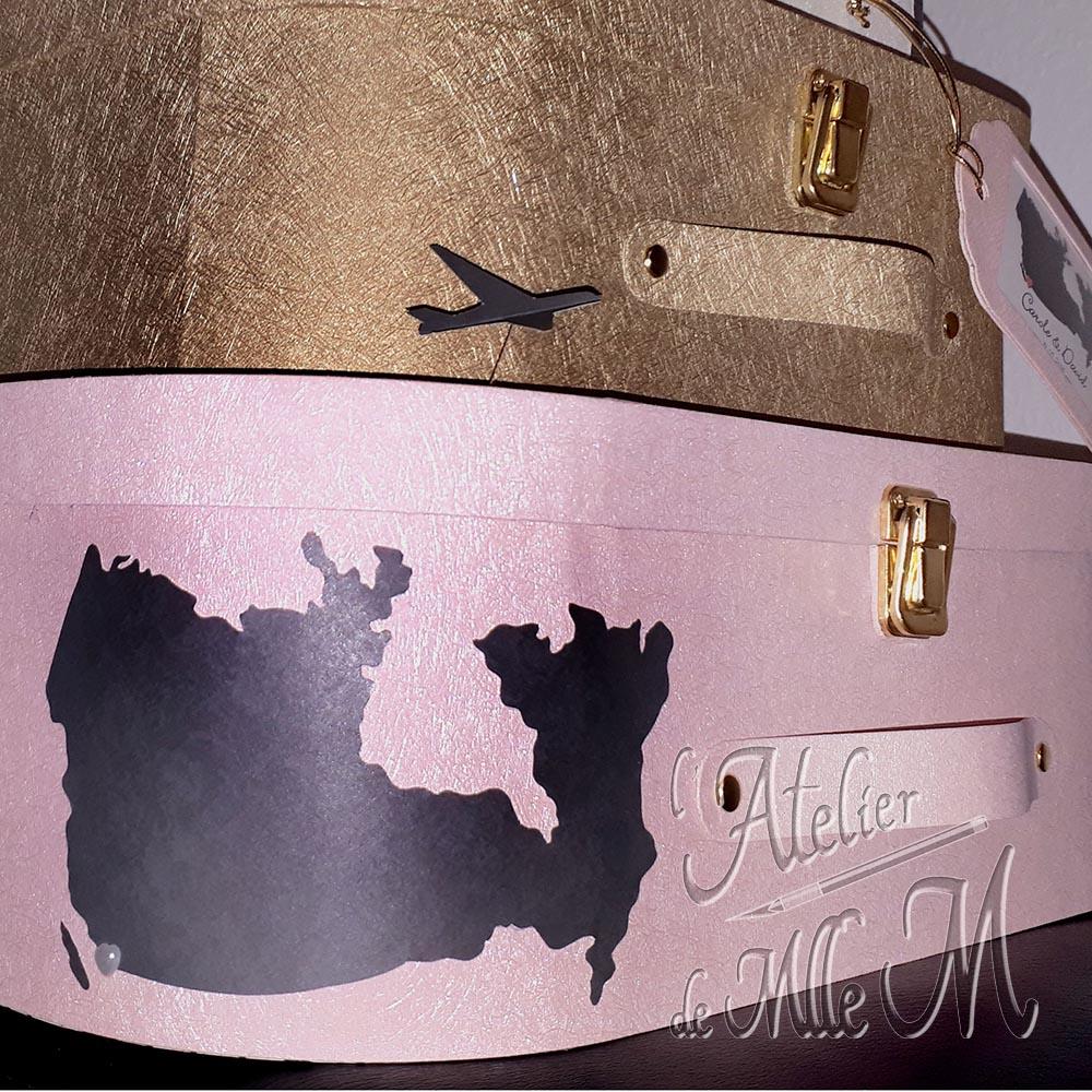 Vue sur les finitions de l'urne de mariage 3 valises sur la thématique du voyage.